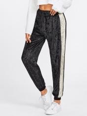 http://fr.shein.com/Contrast-Panel-Side-Crushed-Velvet-Sweatpants-p-389546-cat-1740.html